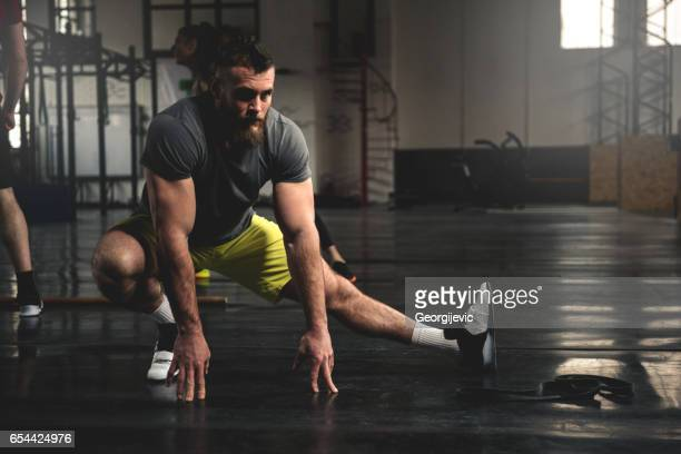 good stretch after training - warming up stock pictures, royalty-free photos & images