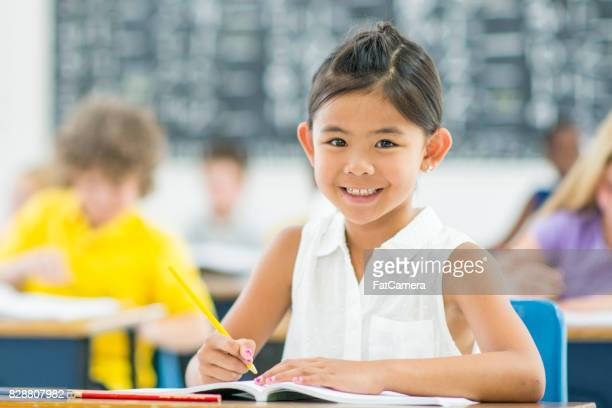 good student - kids reading in classroom stock pictures, royalty-free photos & images