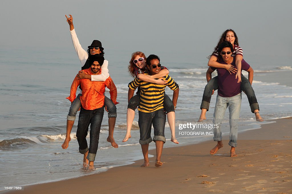 Good time on the beach in India : Stock Photo