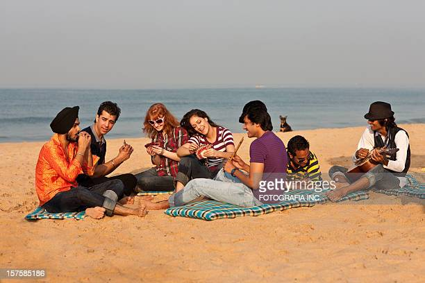 good time on the beach in india - goa stock photos and pictures