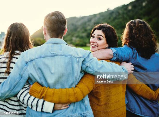 good times are sure to follow with friends like these - clique stock pictures, royalty-free photos & images