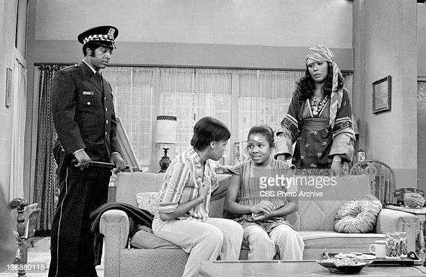 Good Times episode: 'The Evans Get Involved: Part 3'. From left, unidentified as Police Officer, Chip Fields as Mrs. Gordon, Janet Jackson as Penny...