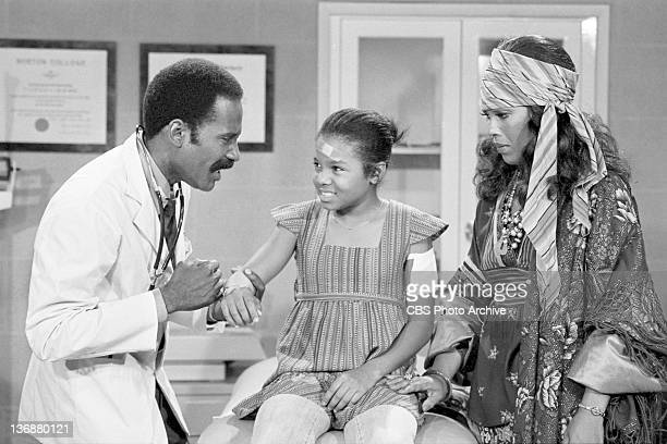 Good Times episode: 'The Evans Get Involved: Part 3'. From left, Bob Delegall as Dr. Blake, Janet Jackson as Penny Gordon and Ja'net DuBois as...
