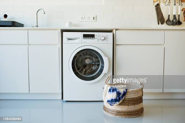 a good washing machine makes the task less daunting - washing machine stock pictures, royalty-free photos & images