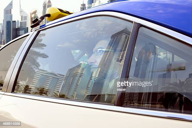 Goodbye Dubai, arab business men in Taxi