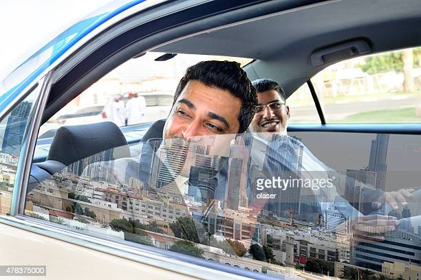 Goodbye Dubai, two arab business men in Taxi