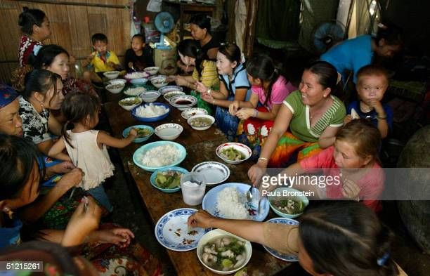A goodbye meal takes place with extended family and friends at a neighbour's home as the Vang family prepare for departure on August 22 2004 in Wat...