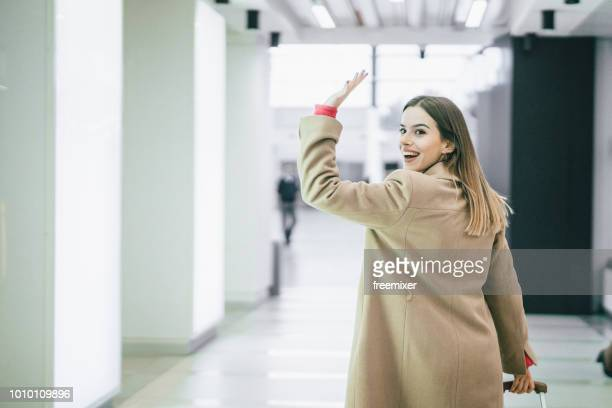 goodbye - waving gesture stock photos and pictures
