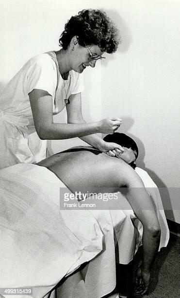 Goodbye stress Massage therapist Corinne Flitton treats controller Hubert Lum who visits SutherlandChan's clinic several times a week Lum 30 says it...
