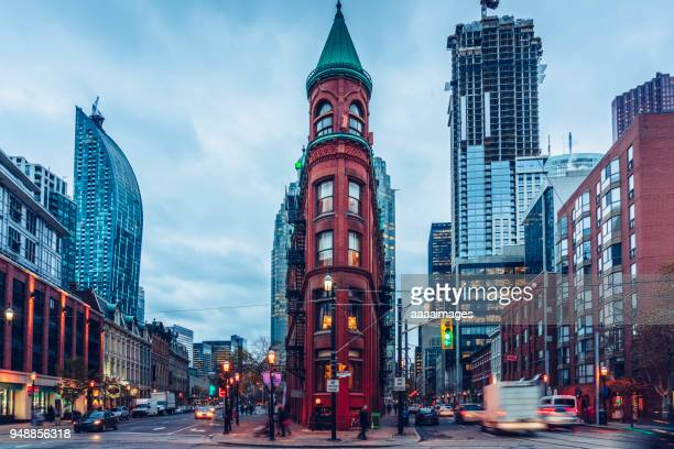 gooderham building at dusk,toronto - toronto stock pictures, royalty-free photos & images