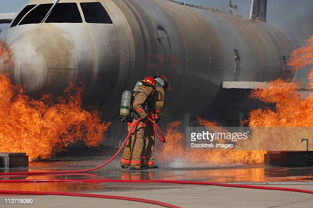 Goodfellow Air Force Base, Texas - Airmen extinguish a fire on a training module to demonstrate an aircraft incident.