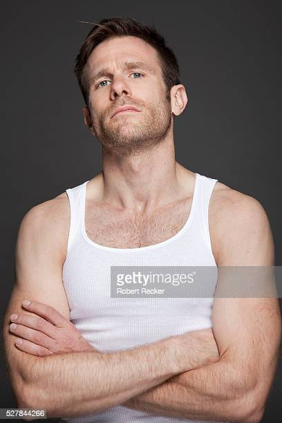 Good-looking mid-adult man with tank top