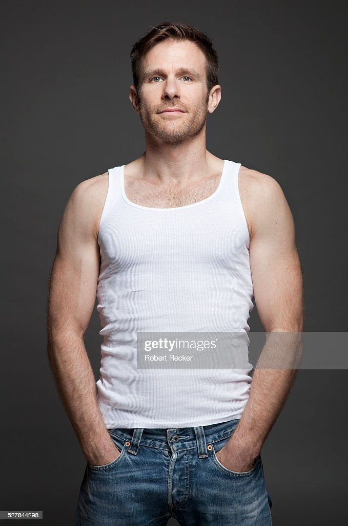 07a41108402a9 Good-looking mid-adult man with tank top   Stock Photo