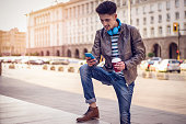 man having some coffee browsing his