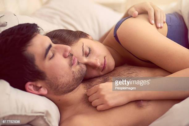 goodnight, sweetheart - romantic young couple sleeping in bed stock photos and pictures