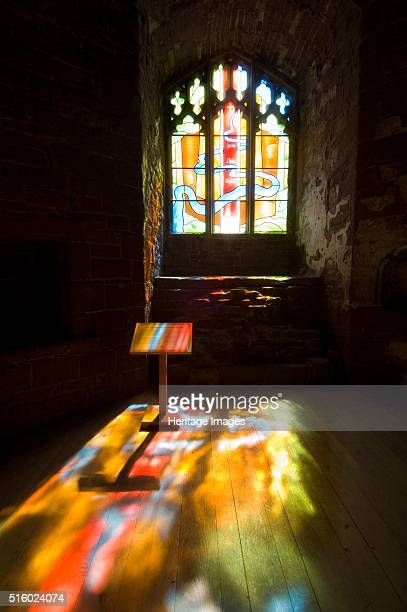 Goodrich Castle Chapel Herefordshire 2007 Interior view of the chapel with light through a stained glass window flooding a lectern and the floor...
