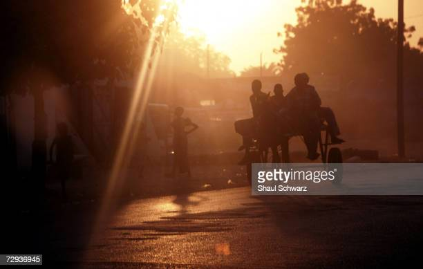 Goods are transported by donkey as the sun sets in the rural village of Dialakoto Senegal August 23 2001 In Senegal rural communities including...