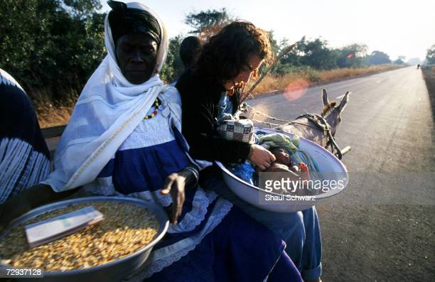 Goods are transported by donkey in the rural village of Dialakoto Senegal August 23 2001 In Senegal rural communities including Dialakoto home to...