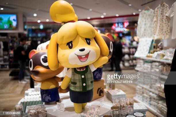 Goods of Nintendo game character Isabelle, known as Shizue in Japan, from the Animal Crossing series of video games are displayed at a new Nintendo...