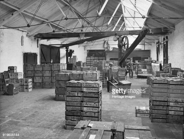 Goods shed West Lancashire Station Fishergate Hill Preston Lancashire 1927 The interior of the Cantrell and Cochrane depot with an employee moving a...