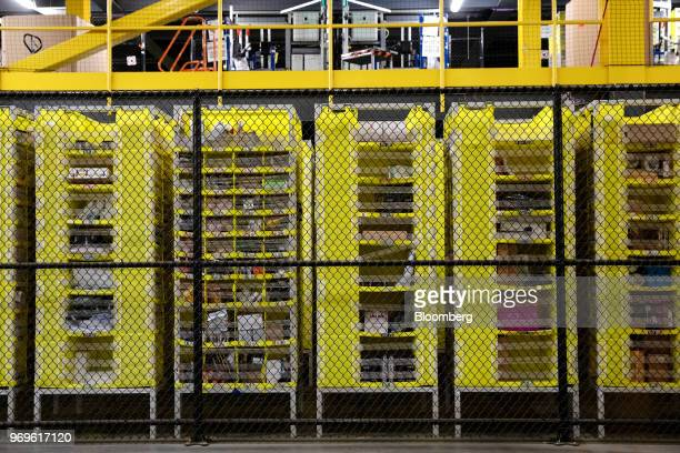 Goods sit in storage units at the Amazoncom Inc fulfillment center in Robbinsville New Jersey US on Thursday June 7 2018 Seattlebased Amazon hasn't...