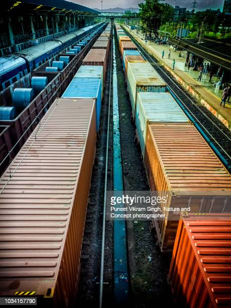 goods train of indian railways carrying steel products and rolls - cargo train stock photos and pictures