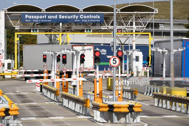 "Goods vehicles pass through the ""pitstop"" area, ahead of boarding the trains to France, on October 03, 2019 in Folkestone, England. The area is for..."