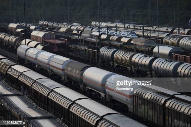 Goods wagons operated by DB Cargo AG stand in a rail yard near Ludwigsfelder Strasse in Munich Germany on Sunday Aug 4 2019 The euro areas biggest...