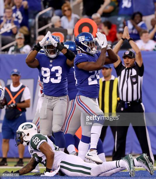 J Goodson Eli Apple and Jason PierrePaul of the New York Giants celebrate the safety as Matt Forte of the New York Jets is on the ground in the first...