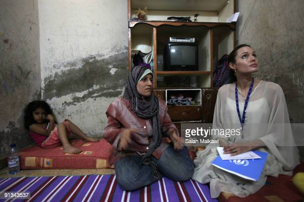 Goodwill Ambassador actress Angelina Jolie checks the living conditions of an Iraqi refugee family living in a suburb on October 2 2009 in Jaramana...