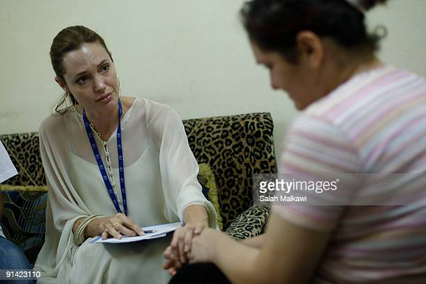 Goodwill Ambassador actress Angelina Jolie listens carefully as an Iraqi refugee living in Damascus Syria shares her traumatic experience in Iraq on...