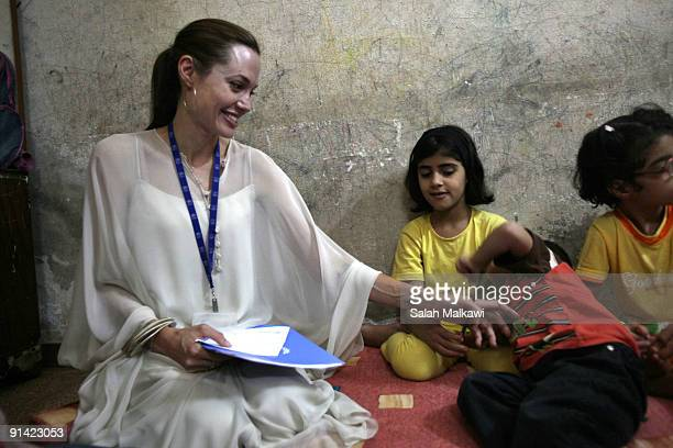 Goodwill Ambassador actress Angelina Jolie visits an Iraqi refugee family living in a suburb on October 2 2009 in Jaramana near Damascus Syria Jolie...
