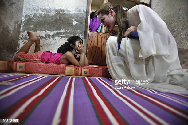 Goodwill Ambassador actress Angelina Jolie visits with the young girl in an Iraqi refugee family living in a suburb on October 2 2009 in Jaramana...