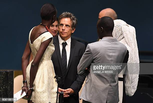 Goodwill Ambassador Alek Wek, actor Ben Stiller and Olympic Refugee Athlete Yiech Pur Biel speak to the #withrefugees group prior to handing over a...