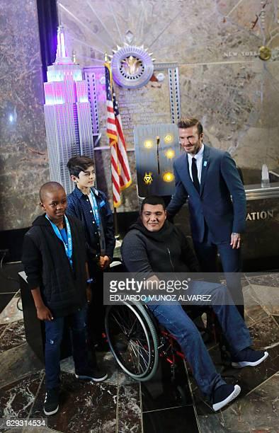 Goodwill Ambassador and former professional footballer David Beckham poses for photos with Remi Van Wyck Mustafa Al Said and Juan Carlos Moran...