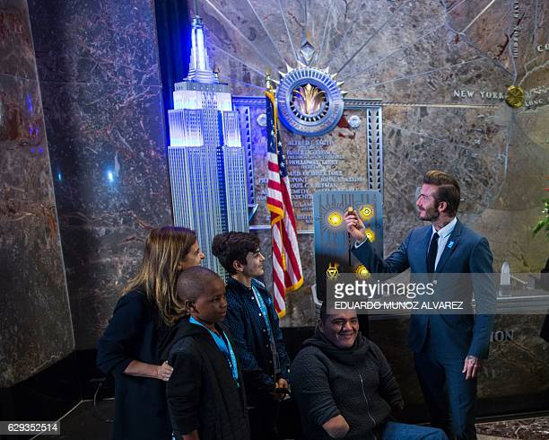 Goodwill Ambassador and former professional footballer David Beckham turns on the lights of Empire State Building next to LR Paloma Escudero Director...