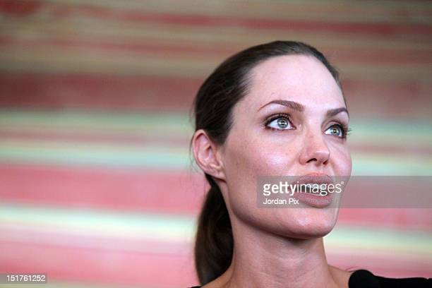 N Goodwill Ambassador and Hollywood actress Angelina Jolie holds a press conference with UNHCR High Commissioner Antonio Guterres during her visit to...