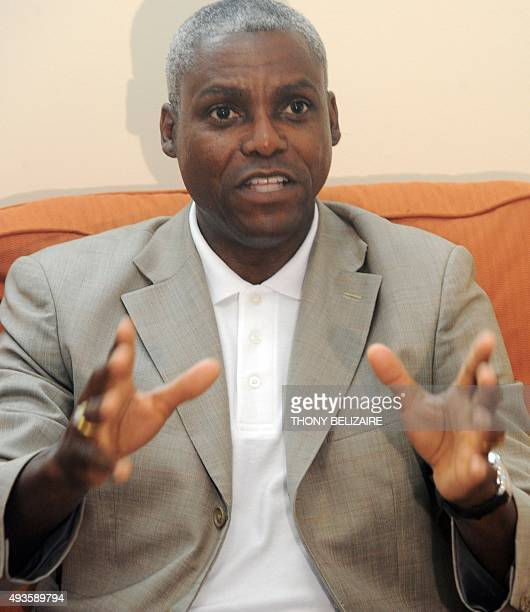 FAO Goodwill Ambassador and Olympic track legend Carl Lewis gestures on June 13 2011 in PortauPrince during his twoday visit to Haiti Lewis saw for...