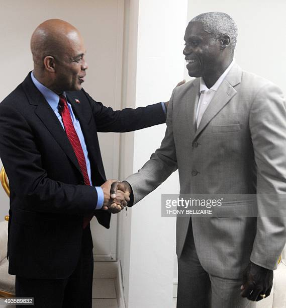 FAO Goodwill Ambassador and Olympic track legend Carl Lewis shakes hands with the newlyelected President Michel Martelly where the issue of...