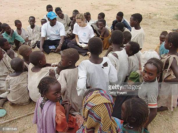 Goodwill Ambassador Angelina Jolie is shown in this UNHCR handout photo talking to children in a displaced persons camp on October 26 2004 in Darfur...