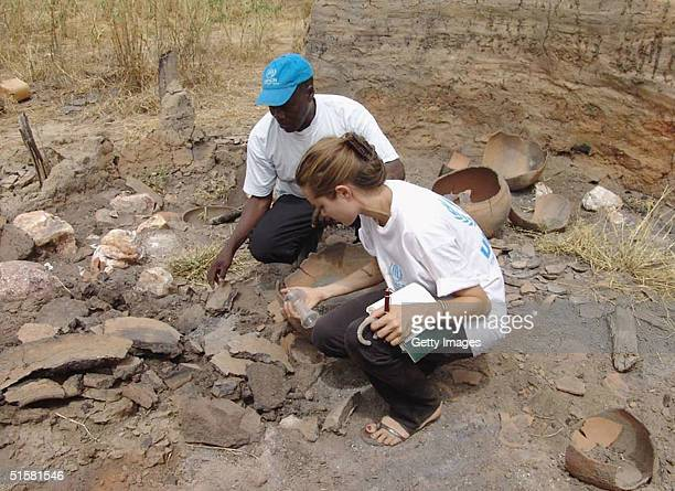 Goodwill Ambassador Angelina Jolie is shown in this UNHCR handout photo examining the remains of a Darfur village after it was destroyed by Janjaweed...