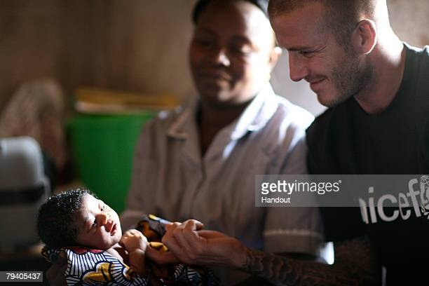 Goodwill Ambassador David Beckham joins nurse Angela as she visits two day old Mariatsu and her mother in their home on January 19 2008 in Mangorea...