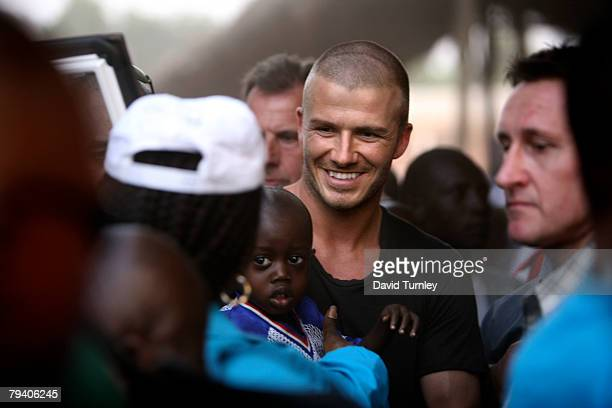 Goodwill Ambassador David Beckham meets fans and players after a game of football with a group of boys during his first field visit with UNICEF to...
