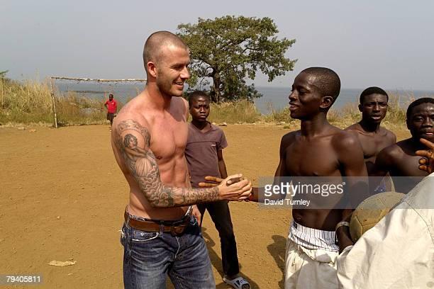 Goodwill Ambassador David Beckham participates in a roadside football game on January 19 2008 in the Aberdeen neighbourhood of Freetown Sierra Leone...