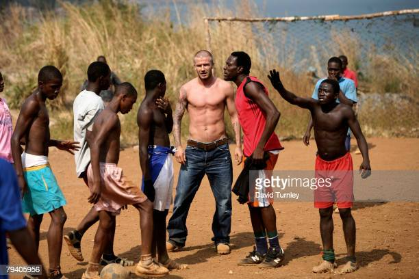 Goodwill Ambassador David Beckham participates in a roadside football game on January 19 2008 in the Aberdeen neighborhood of Freetown Sierra Leone...
