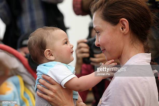 Goodwill ambassador for the United Nations Population Fund and actress Ashley Judd interacts with a Syrian refugee child during her visit to the...
