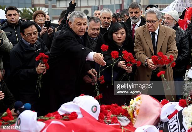 Goodwill Ambassador Phan Thi Kim Phuc Turkish musician author poet and journalist Zulfu Livaneli and Mayor of Sariyer Sukru Genc leave carnations to...