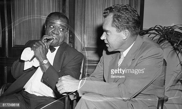 Goodwill Ambassadors. Washington: Using his favorite mouthpiece, Louis Armstrong, famed musician, demonstrates to Vice President Richard M. Nixon the...