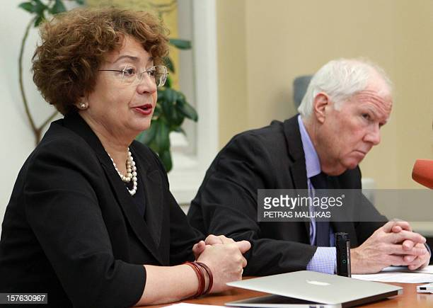 Goodwill compensation fund chairmen Faina Kukliansky and Andrew Baker attend a press conference in Vilnius on December 5 2012 AFP PHOTO / PETRAS...