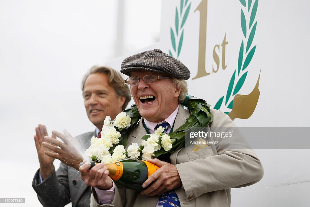 Goodwood Festival's director Charles Henry Gordon-Lennox, Earl of March and Kinrara and Dan Gurney attend the Goodwood Revival 2012 on September 16, 2012 in Chichester, United Kingdom.